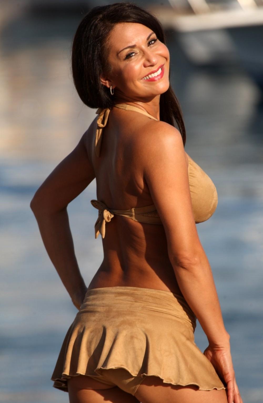 587ca33696 More Views. Faux Suede Vogue Skirted Bikini ...