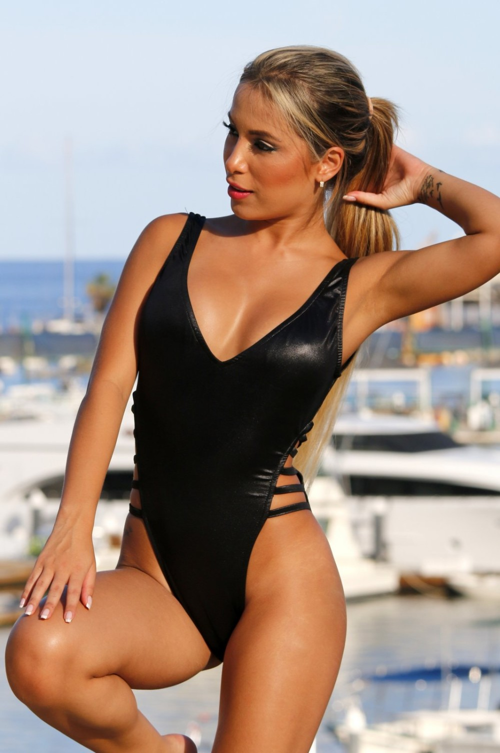 e22e10ee502e6 UjENA Strappy Slick High Cut One Piece Swimsuit. FREE Shipping ...