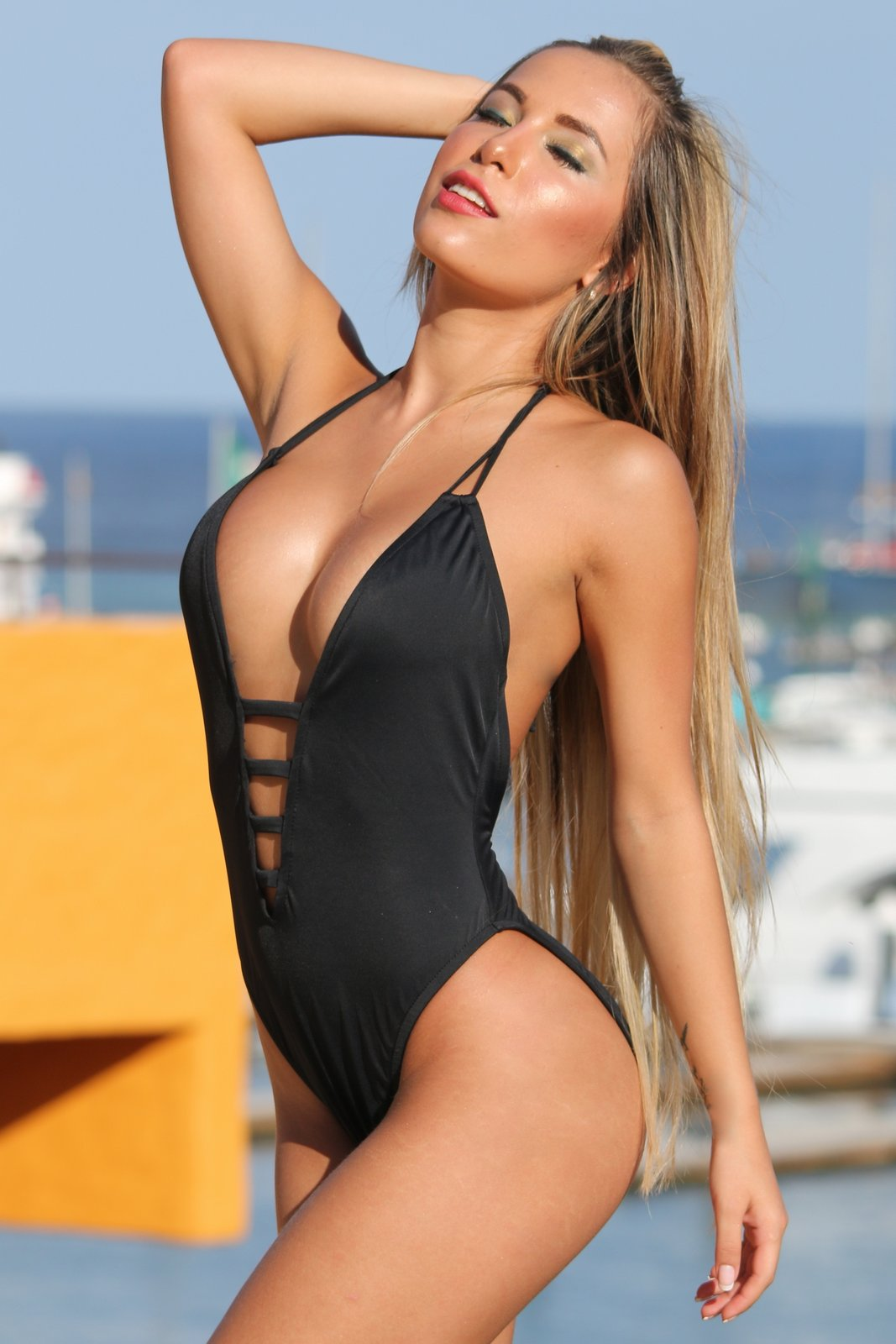 d6ea153a17c43 UjENA Black Plunge with Straps One Piece. FREE Shipping with code 1300.